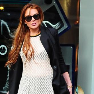 Lindsay Lohan's Dad Slams Her Friends