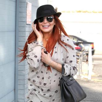 Lindsay Lohan's Dad Worries She'll Die