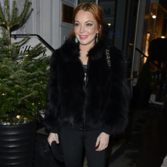 Lindsay Lohan Working On Relationship With Dad