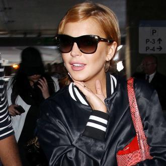 Lindsay Lohan Makes Fun Of Kristen Stewart