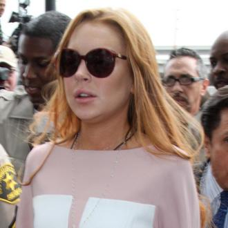 Linsday Lohan Jokes About Rehab