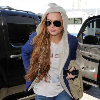 Lindsay Lohan Hits The Gym