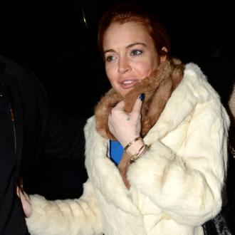 Lindsay Lohan Loses Half A Fur Coat