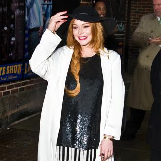 Lindsay Lohan Jets To Coachella