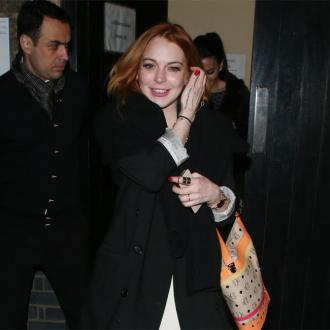 Lindsay Lohan Watches Rita Ora At London Gig