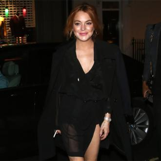Lindsay Lohan Streaks Around Selfridges
