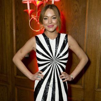 Lindsay Lohan Falls For City Banker