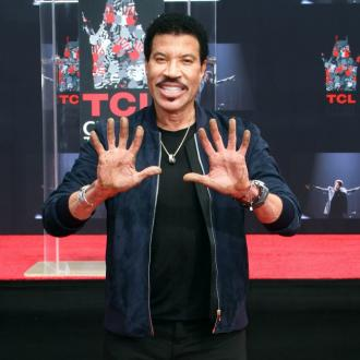 Lionel Richie honoured with concrete handprints at TCL Chinese Theatre