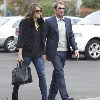 Liz Hurley and Shane Warne split