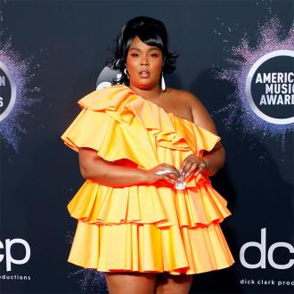 Lizzo Brings Tiny Bag To American Music Awards