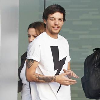 Louis Tomlinson won't pressure son to go into showbiz
