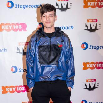 Louis Tomlinson Says Watching One Direction Stars Perform Is 'Surreal'