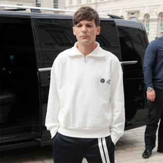 Louis Tomlinson used to be a 'cocky sh*t'
