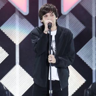 Louis Tomlinson splits from Syco label