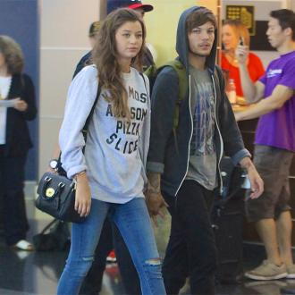 Louis Tomlinson's girlfriend 'attacked by two females at LAX'