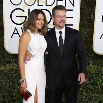 Matt Damon and Luciana Barroso look in love at concert