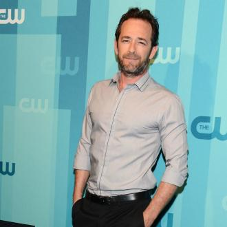 Luke Perry buried in eco-friendly mushroom suit