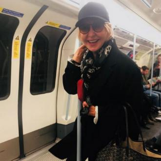 Lulu forced to stand on packed tube