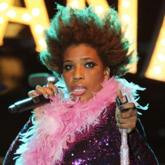 Macy Gray Always Carries Cards