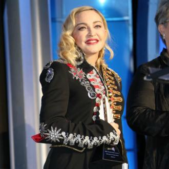 Madonna's twins think it's funny she's famous