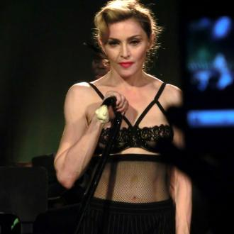 Madonna sued over lateness