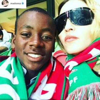 Madonna and David cheer on Portugal