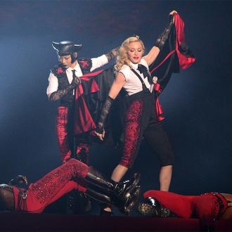 Material Hurl: Madonna Falls Off Stage At Brit Awards