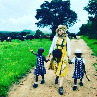 Madonna adopts twin sisters