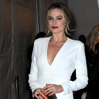 Margot Robbie proud to be woman