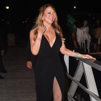 Mariah Carey 'hand-in-hand' with backup dancer