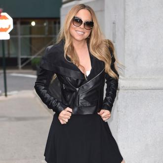 Mariah Carey stays positive amidst split
