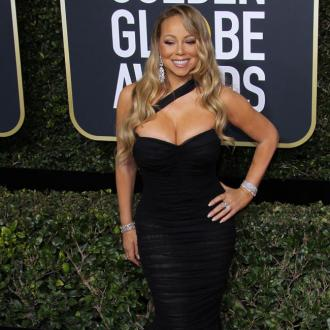 Mariah Carey tailors stage outfits to her figure