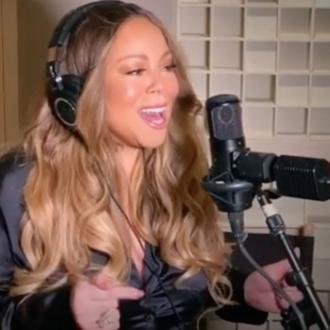 Mariah Carey performs Always Be My Baby with 'fan' blowing her hair