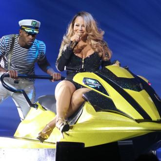 Mariah Carey Swims In High Heels