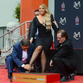 Mariah Carey plunges $900 heels into cement