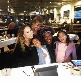 Nick Cannon out of hospital and back with family