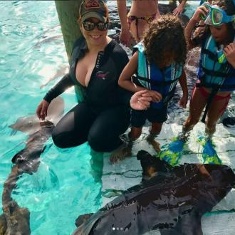 Mariah Carey goes swimming with sharks