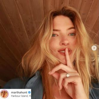 Martha Hunt engaged