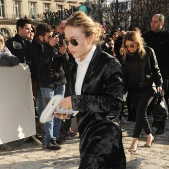 Mary-Kate Olsen 'learns' to brush her hair