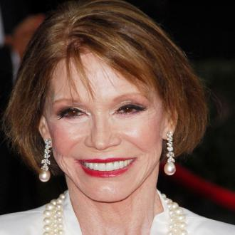 Mary Tyler Moore's widower wants to see her smile again
