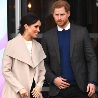 Prince Harry and Meghan Markle ask wedding guests to donate