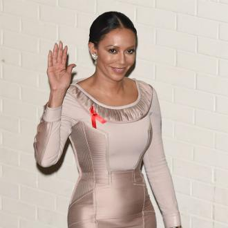 Mel B Turns To Ex Eddie Murpy For Support