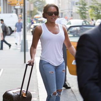 Mel B 'Addicted' To Husband