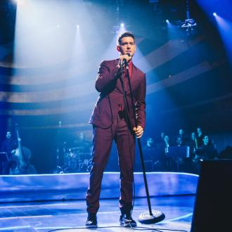 Michael Buble won't perform until son is well