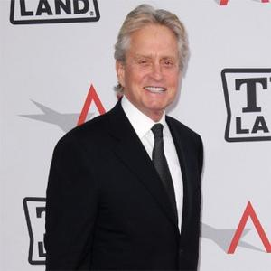 Michael Douglas Supported By Children