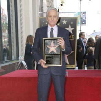 Michael Douglas receives Hollywood Walk of Fame star