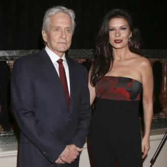 Michael Douglas praises wife Catherine Zeta-Jones for 'earning' her success