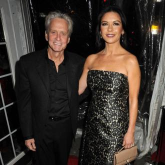 Michael Douglas And Catherine Zeta-jones In Regular Contact