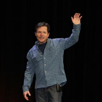 Michael J Fox laughs at disease