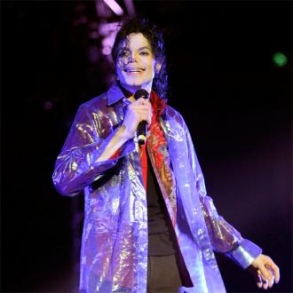 Michael Jackson's pet Bubbles paints for charity auction